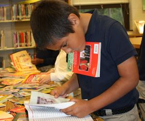 boy-holding-book-under-chin